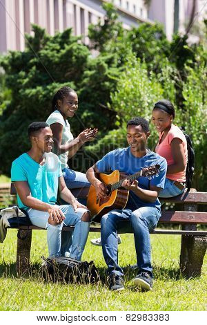 group of cheerful african american college friends having fun on campus