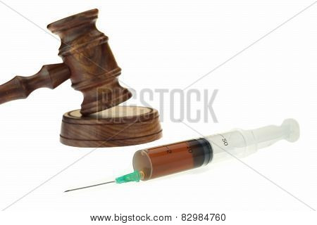 Judges Gavel And Syringe With Brown Liquid Isolated