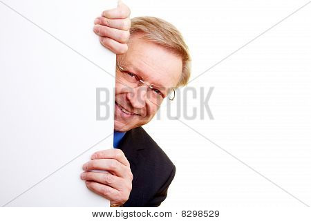 Businessman Behind White Wall