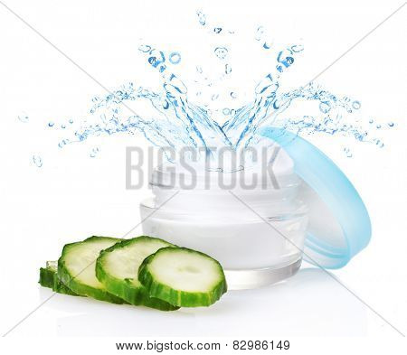 Cream with water splashing and fresh sliced cucumber isolated on white