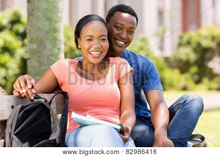 portrait of happy young african college couple outdoors
