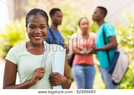 gorgeous afro american college student looking at the camera