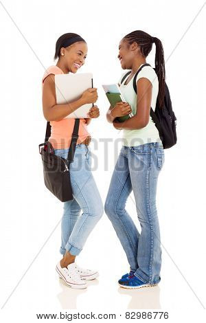 cheerful young female african college students having conversation on white background
