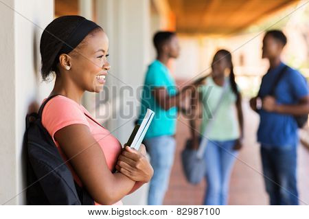 pretty female afro american college student looking away