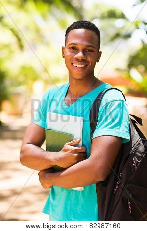 handsome male afro american university student standing outdoors on campus