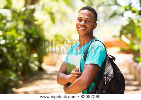 portrait of handsome young african college boy on campus