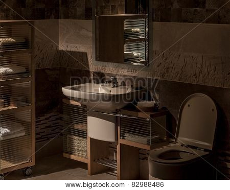 Detail Of A Modern Bathroom With Sink, Cabinet For Towels And Toilet