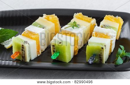 canape with fruits and cheese