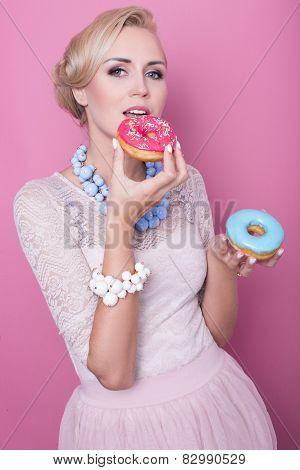 Beautiful blonde women taste colorful dessert. Fashion shot. Soft colors