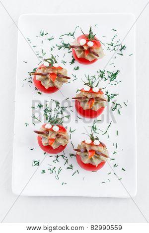 Many small tomatoes stuffed with eggplant baba ganoush