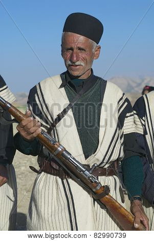 Man holds a rifle on circa Isfahan, Iran