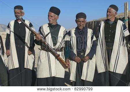Men wear traditional dresses circa Isfahan, Iran.