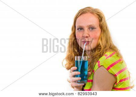 Redhead girl drinking blue soft drink