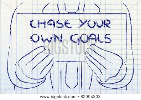 Business Man Holding Sign Saying Chase Your Goals