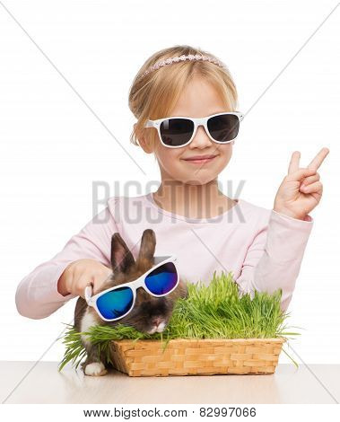 Little girl and bunny in sunglasses