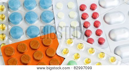A Variety Of Different Colored Pills