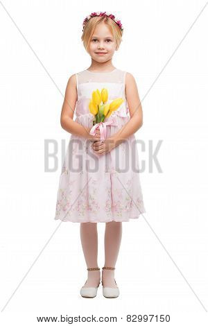 Cute little girl with bouquet of yellow tulips