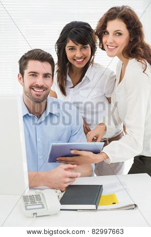 Portrait of smiling coworkers looking at camera in the office