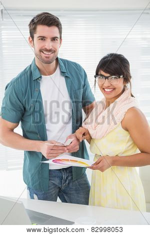 Portrait of smiling designer with her client in the office