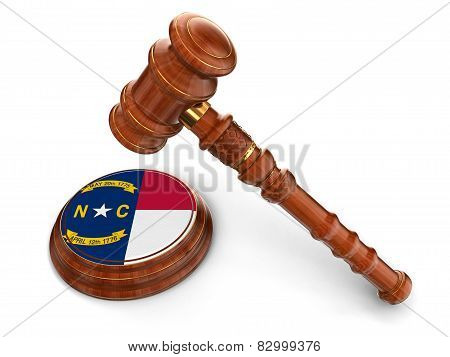 Wooden Mallet and flag Of North Carolina (clipping path included)