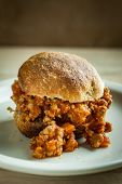 stock photo of whole-wheat  - A rustic sloppy joe made with fresh whole wheat rolls and fresh ingredients. ** Note: Shallow depth of field - JPG