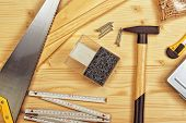 picture of carpentry  - Assorted Woodwork and Carpentry or Construction Tools on Pine Wood Texture Background - JPG