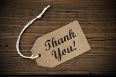 pic of thankful  - Close Up Of A Brown Label With White Ribbon On Wooden Background With English Text Thank You Frame And Vintage Or Retro Style - JPG