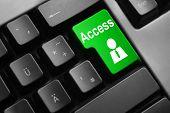 picture of vpn  - dark grey keyboard green access button user - JPG