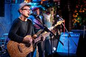 Постер, плакат: Band performs on stage rock music concert Warning authentic shooting with high iso in challengin