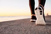picture of sunrise  - Runner man feet running on road closeup on shoe - JPG
