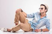 foto of knee  - cool fashion man lying on the floor - JPG