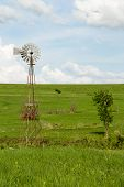 picture of kansas  - A windmill in a field in the Flint Hills of Kansas - JPG