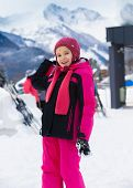 foto of snowball-fight  - Cute smiling girl throwing snowball at highland resort - JPG