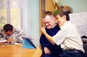 picture of health center  - happy friends with disability socializing through internet - JPG