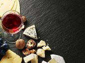 foto of brie cheese  - Different types of cheeses with wine glass and fruits - JPG