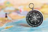 foto of compasses  - compass on the tourist map - JPG