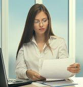 picture of secretary  - Young woman secretary at work at the office - JPG