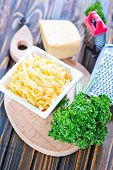picture of grating  - grated cheese in bowl and on a table - JPG