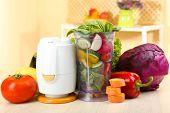 foto of blender  - Blender with fresh vegetables on kitchen table - JPG