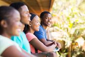picture of young boy  - cheerful young african college boy with friends on campus - JPG