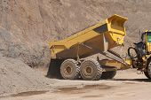 picture of dumper  - Truck and bulldozer work in the quarry - JPG