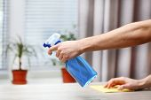 pic of window washing  - Male hands with sprayer and rag wash windowsill on window background - JPG