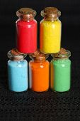 pic of pigment  - Bottles with colorful dry pigments on dark background - JPG