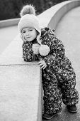 foto of overalls  - Adorable little girl for a walk in a winter overalls (black and white)