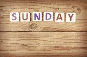 stock photo of weekdays  - The word SUNDAY written in wooden letterpress type - JPG