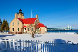 picture of blanket snow  - Old Mackinac Point Lighthouse in Mackinaw city sits in a blanket of snow on this sunny Michigan day - JPG