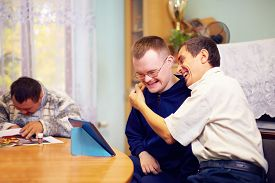image of daycare  - happy friends with disability socializing through internet - JPG