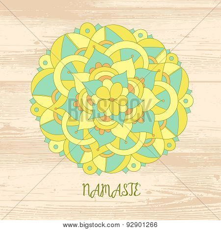 Namaste card. Cute mandala on the wood background.