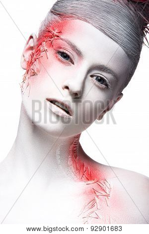Art fashion girl with white skin and red paint on the face.  Creative art beauty.