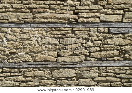 Old Stone Wall Closeup With Two Beams